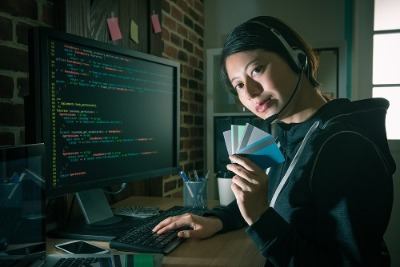 female hacker with cards